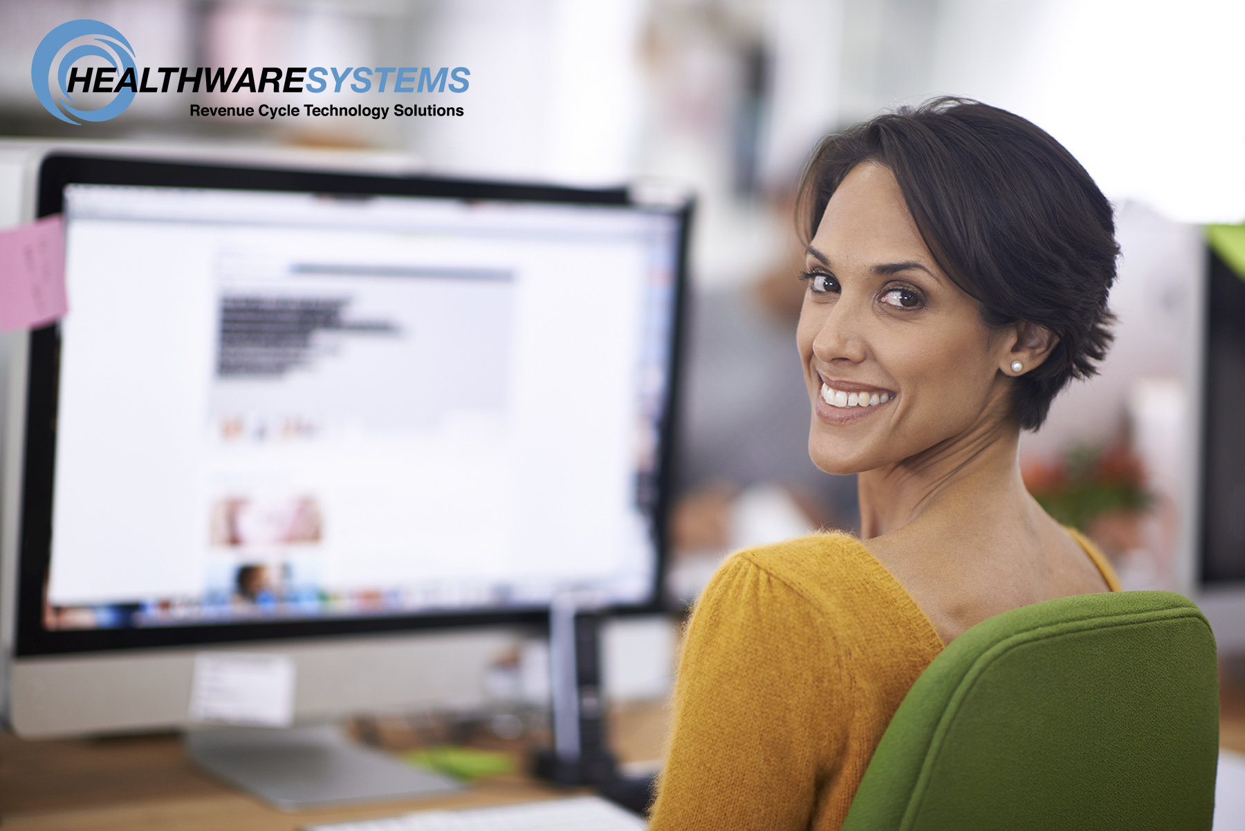 Employee Satisfaction: A healthcare employee smiles at her desk.