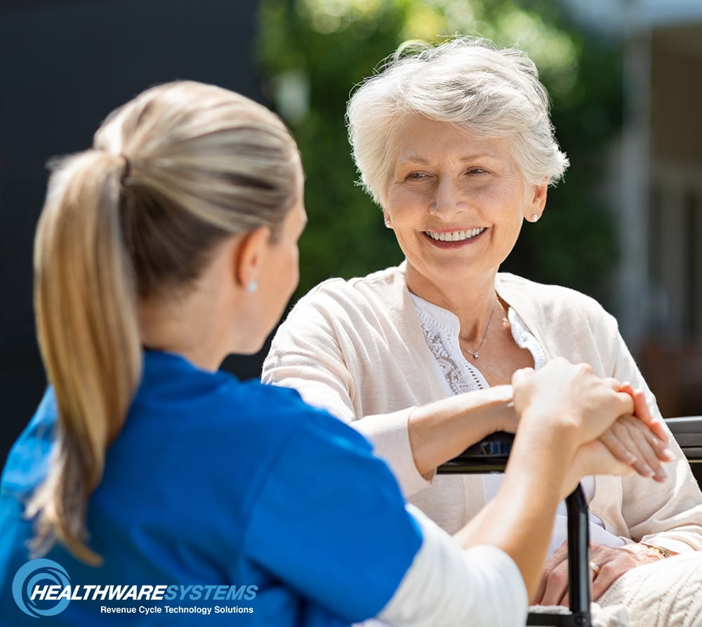 A nurse speaks with an elderly patient: Directing assistance toward at-risk patients can reduce hospital readmission rates.