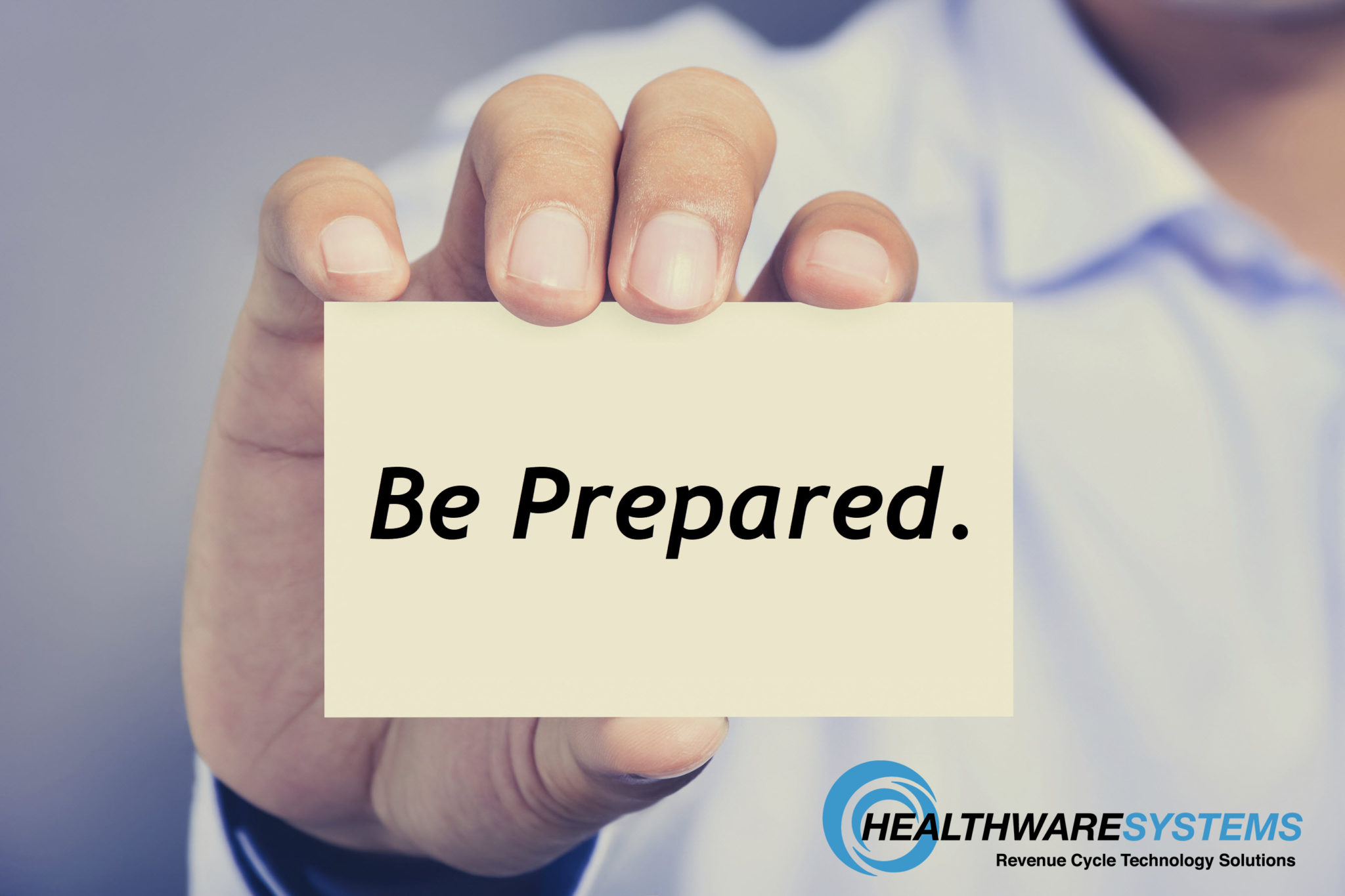 """Preparing for a Doctor's Appointment: A person holds a card that reads """"Be Prepared."""""""