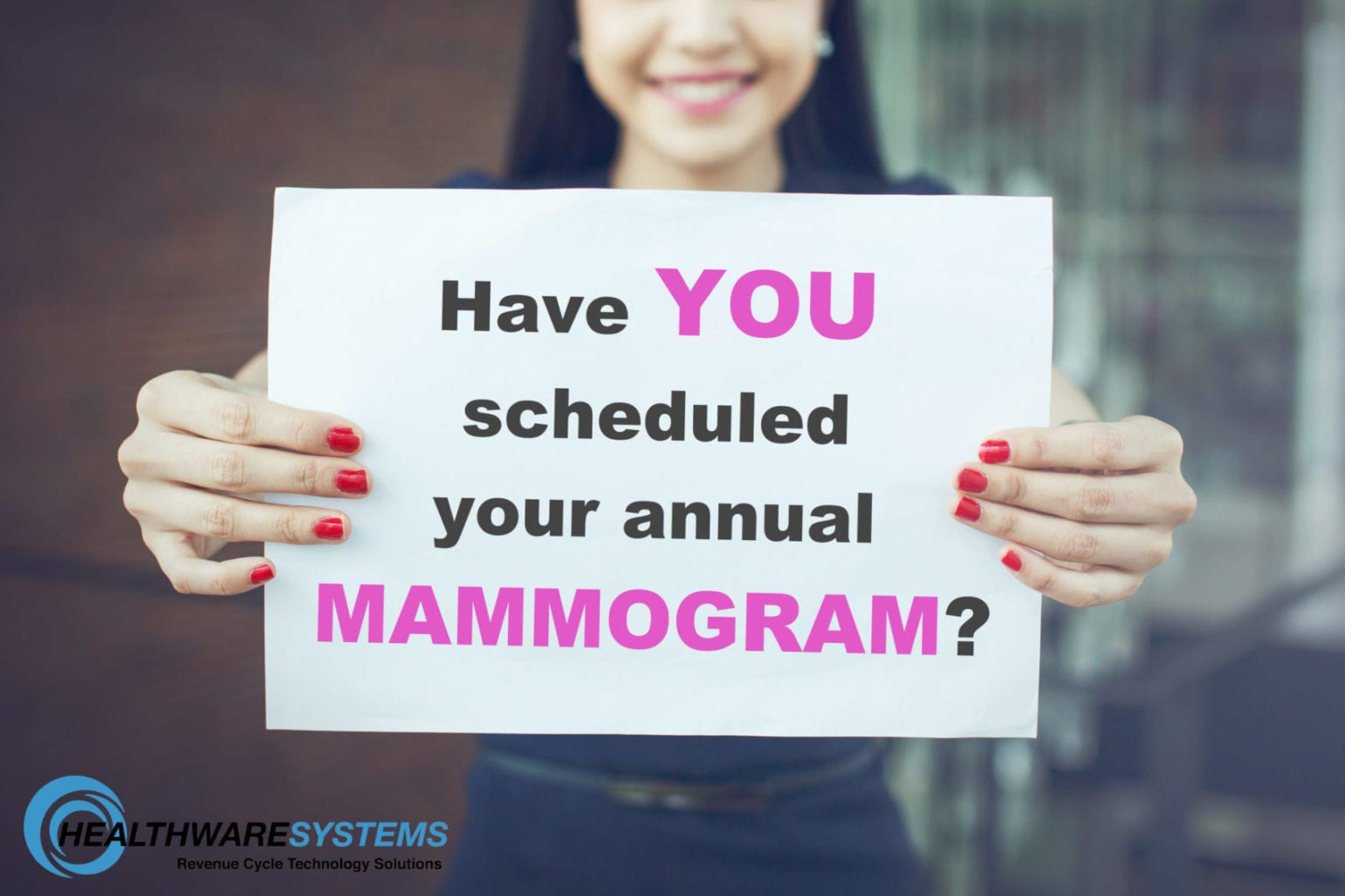 "Increasing mammogram appointments… a woman holds a sign reading ""Have YOU scheduled your annual MAMMOGRAM?"""