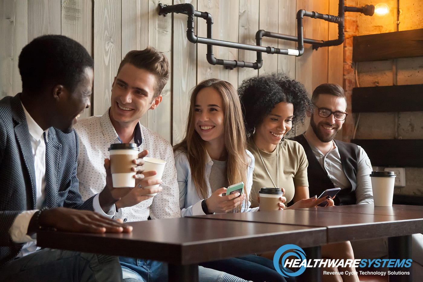 Appealing to Millennial patients: Millennials gathered at a table with smart phones and coffee.