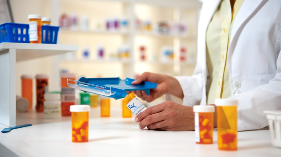 A pharmacist fills prescriptions: Improving interoperability in healthcare can help prevent adverse drug events that affect public health and patient safety.