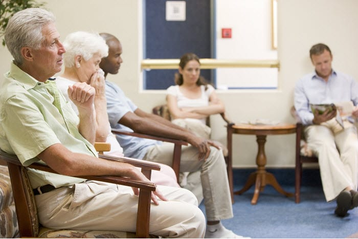 Managing the flu season: Sick patients sit in the waiting room.