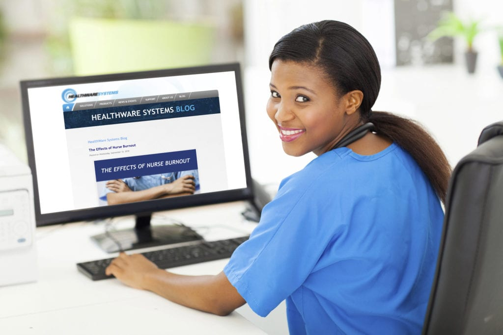 A nurse reads the HealthWare Systems blog to address nurse burnout.
