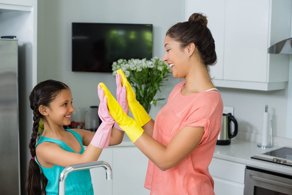 A daughter and mother celebrate the health benefits of a clean home.