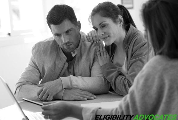 A couple struggling with patient financial stress seeks the help of a patient eligibility service.