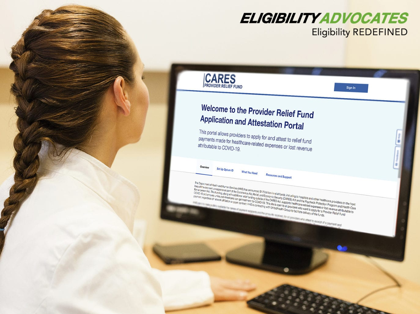 A provider looks at the CARES Act Provider Relief Fund Application and Attestation Portal on her desktop computer.